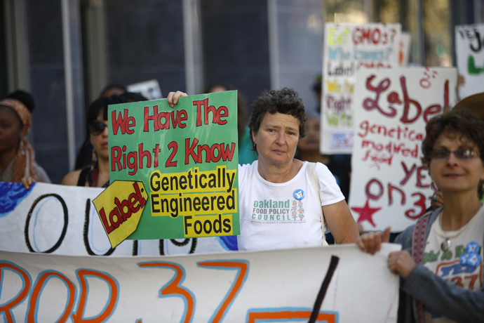 A demonstrator holds a sign during a rally in support of the state's upcoming Proposition 37 ballot measure in San Francisco