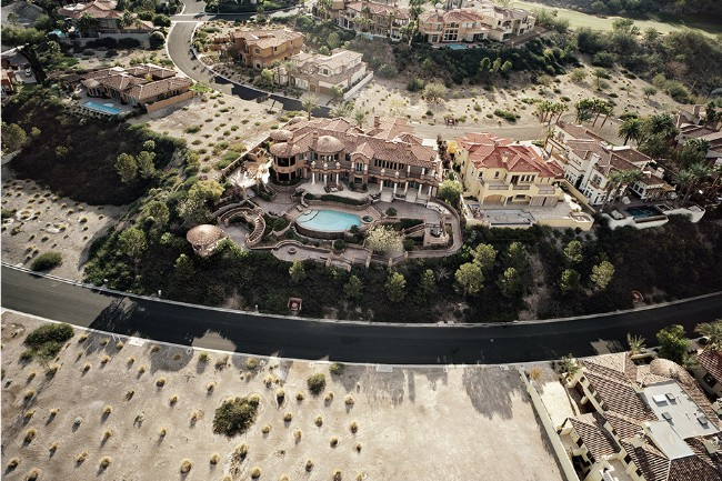 Economic Collapse Seen Through Aerial Photos of Abandoned Mansions