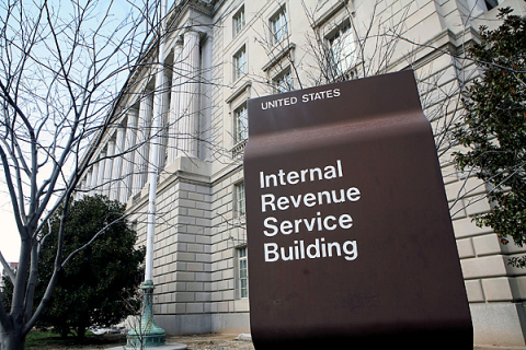 A sign identifies the Internal Revenue Service building on C