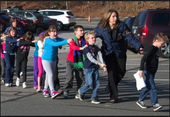 Teacher-leading-students-away-from-Sandy-Hook