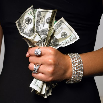 Woman's Hand Holding Money