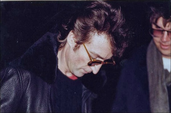 John Lennon signs an autograph for Mark Chapman - his murderer, December 8, 1980