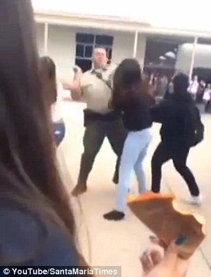 Male Cop Punches Female Student In Face During School Fight