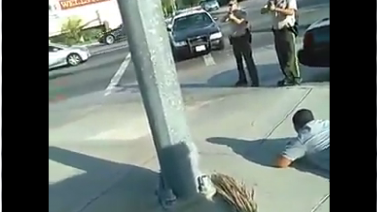Dramatic Video Shows Man Refusing to Lie Down For Police, Despite Guns Pointed at Him