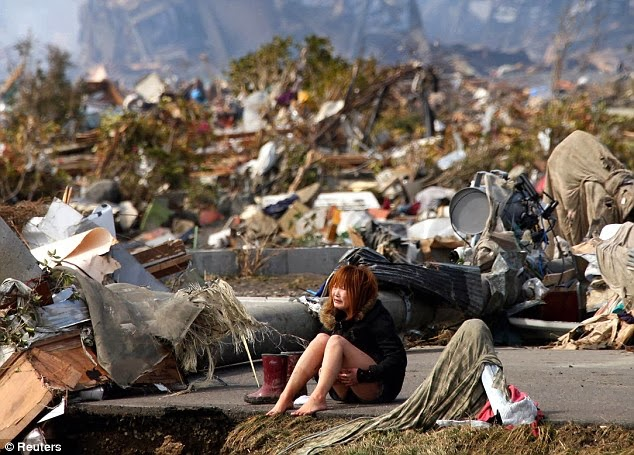 Girl devastated after the tsunami that hit Japan in 2011