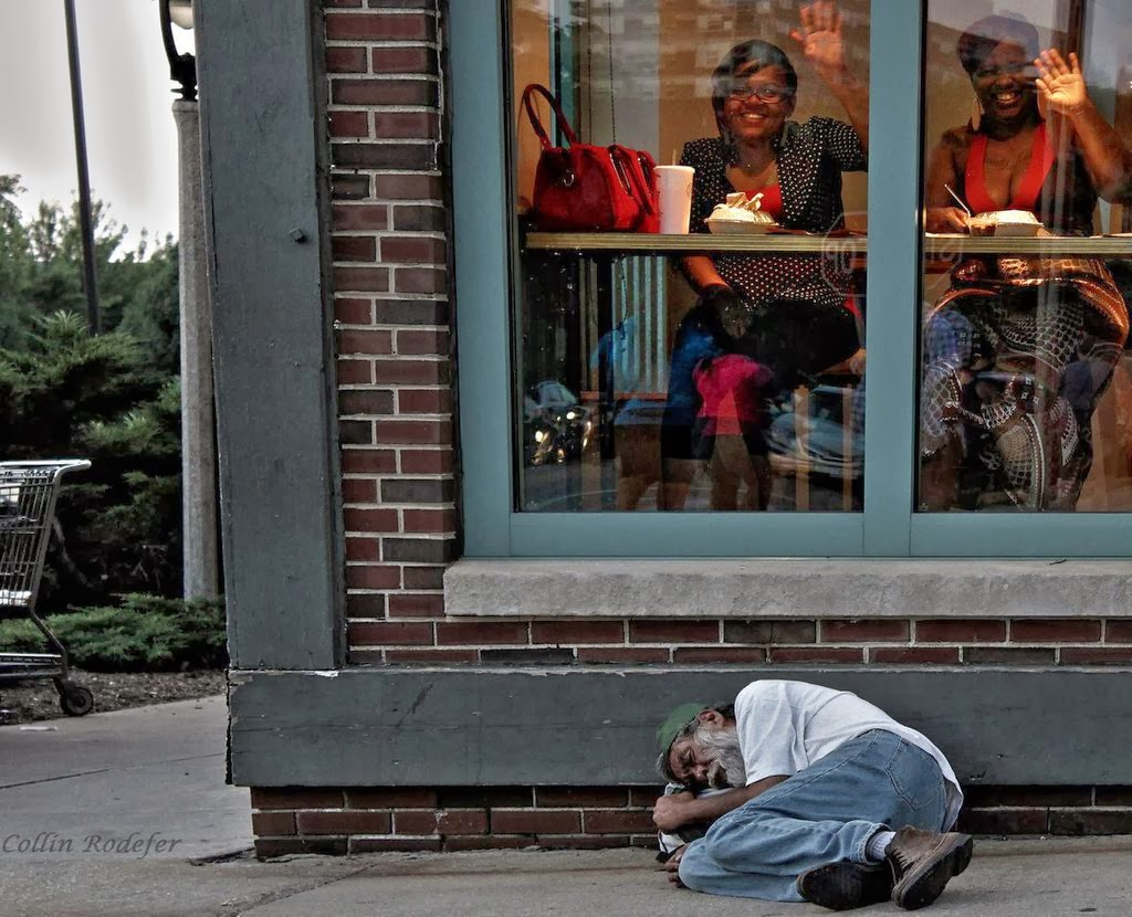 Ignorance_is_bliss_Homeless_man_sleeps_outside_a_diner_in_Milwaukee