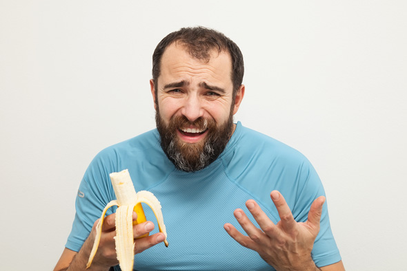 man-unhappy-about-eating-a-banana