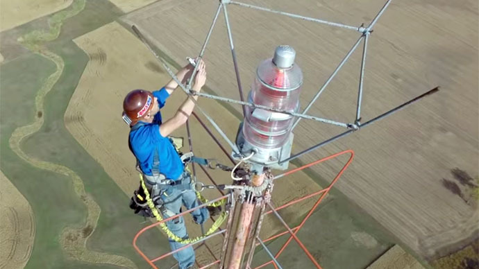 Stunning Drone Footage Shows Man Changing Light Bulb at 1,500 Feet