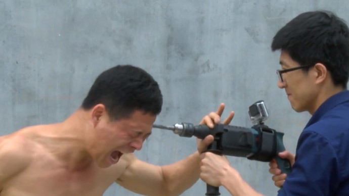Shaolin Kung-Fu Master Uses Electric Drill on His Skull