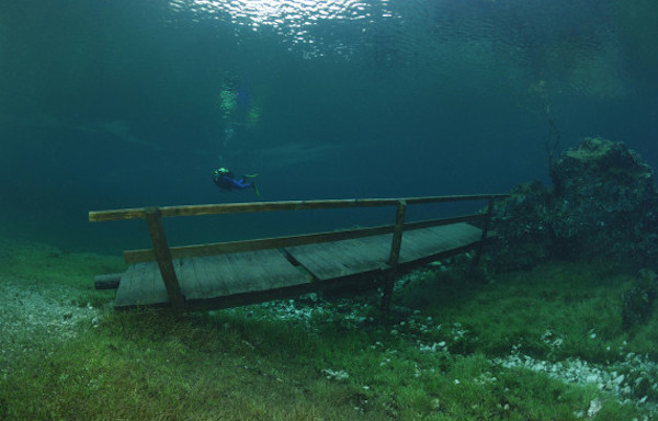 Wooden bridge in overflowed Green Lake