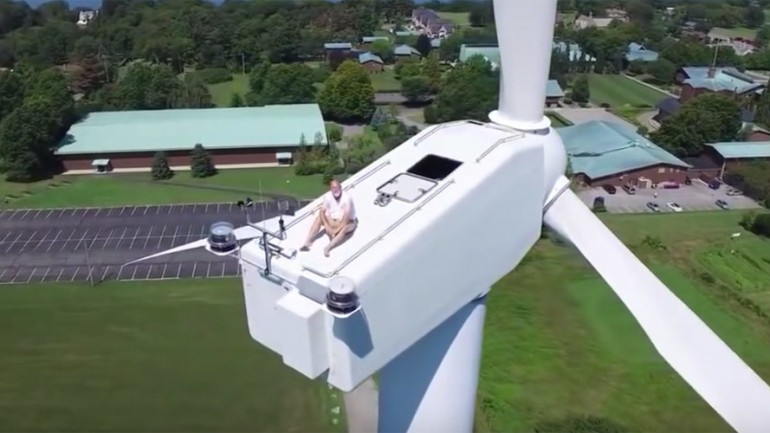 Drone Finds Man Sunbathing Atop Wind Turbine