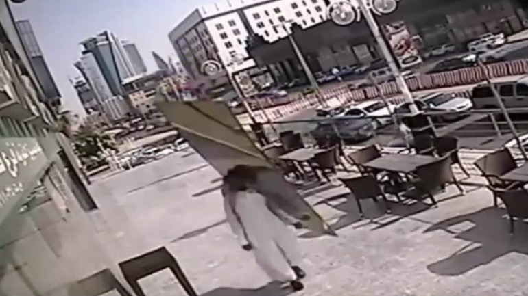 Huge Glass Panel Falls Inches From Saudi Man's Head