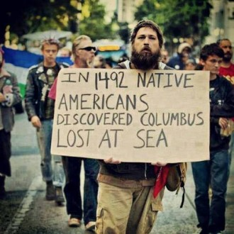 Celebrating-Genocide-–-Christopher-Columbus-Conquest-of-America-In-1492-Native-Americans-Discovered-Columbus-Lost-at-Sea--330x330