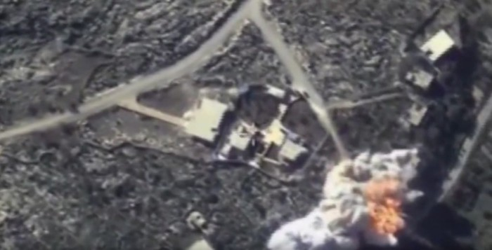 This photo made from the footage taken from Russian Defense Ministry official web site Monday, Nov. 23, 2015 shows local Islamic State group headquarters hit by two cruise missiles during the attack of Russian warplanes in Syria. Russia's President Vladimir Putin was in Tehran on Monday for talks with Iranian leaders expected to focus on the Syrian crisis and an international peace plan intended to end the conflict. (AP Photo/Russian Defense Ministry Press Service)