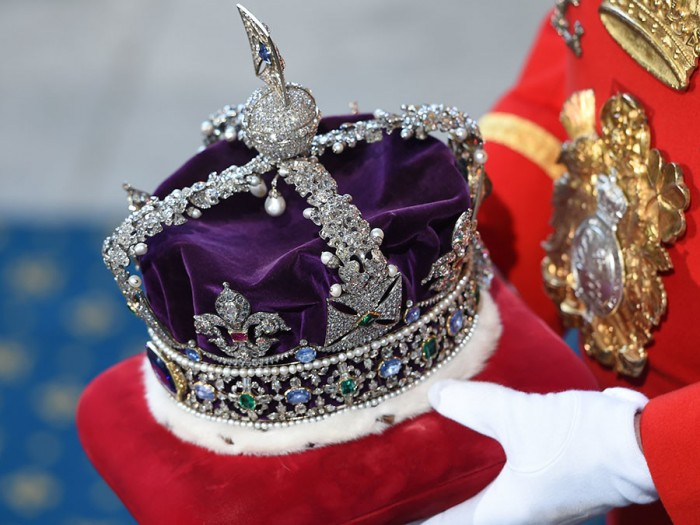 Britain's Queen Elizabeth's Imperial State Crown arrives at the Royal Gallery before the State Opening of Parliament in the House of Lords, at the Palace of Westminster in London, Britain, May 27, 2015. REUTERS/Eddie Mulhollan/Pool - RTX1ERXE