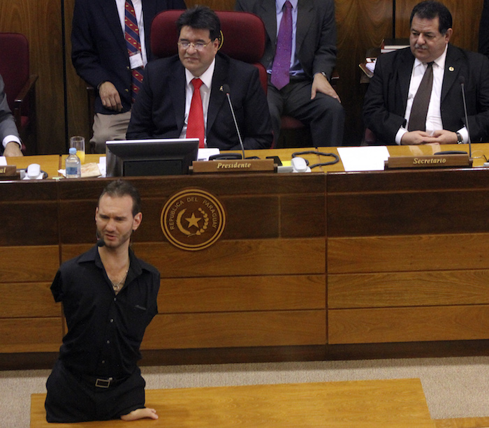 Australian Christian preacher Nicholas James Vujicic, director of Life Without Limbs organization, speaks before the congress in Asuncion, on October 17, 2013. Vujicic arrived in Paraguay to give a series of lectures for youngsters. AFP PHOTO/STR (Photo credit should read STR/AFP/Getty Images)