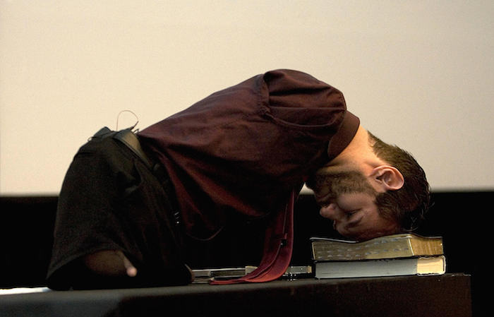 Australian motivational speaker, Nick Vujicic, born without legs or arms, demonstrates how he gets up without help while giving a conference at a hotel in San Jose on February 5, 2009. Vujicic is on a visit to Costa Rica to deliver several speeches about his life, as well as the organization for the physically disabled that he manages, Life Without Limbs. AFP PHOTO/ Mayela LOPEZ (Photo credit should read MAYELA LOPEZ/AFP/Getty Images)