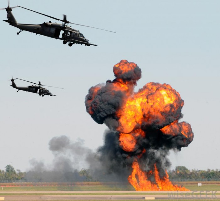blackhawk-helicopters-flying-over-explosion