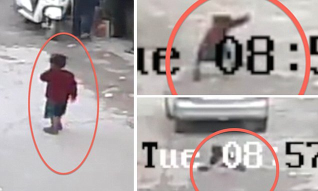 This is the shocking moment a four-year-old girl is run over by a car - and the driver doesn't even stop. The little girl miraculously survives the horrendous incident and you can see her picking herself up after the car drives away. The shocking footage was captured on CCTV in the Vasant Kunj area of New Delhi, India, at 9am on January 12 and shows little Jyoti Choudhary walking onto the road close to her home before falling over and the car driving over her. Eye witness, Raj Singh, 40, who saw the incident unfold from his nearby office as a property dealer, said: 'I saw the car running over the little girl, I ran towards her but by the time I got to her she was already up and walking. She was scared and crying but was fine within a few minutes. I checked her for any injuries but she seemed fine. It's a miracle she walked out of the incident unhurt.' He added that the driver of the car didn't even realise what he had done as he drove away. Jyoti's mother, Meenu, 25, was feeding her 18-month-old daughter Sunny at home when little Jyoti escaped through the front door. Her father, Venod, 30, a rickshaw driver was out at work. 'I was at home feeding my other kids when Jyoti ran out of the house,' Meenu said. 'The first I knew of anything was when my neighbours brought Jyoti back to me and informed me about the incident. 'I am truly blessed to see my child safe and home. It could have been a lot worse. It's a miracle. I wouldn't have forgiven myself if something had happened to her.' Jyoti, who often goes wondering without her parents knowledge said: 'I got scared but didn't move.' According to her teacher, Meenakshi, 45, at Samarpan School, in Kishangarh, New Delhi, Jyoti is an adventurous little girl. 'It's always difficult to keep her sitting still. She runs from one corner to the other in a blink of an eye. I'm not surprised she went wandering out of the house and onto the road. She is blessed she managed to escape the incident unscathed.'