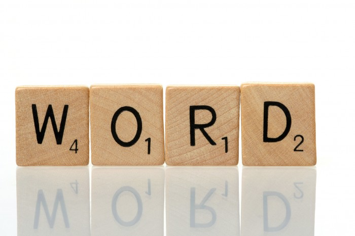 Word cinstruction with scrabble blocks on white background