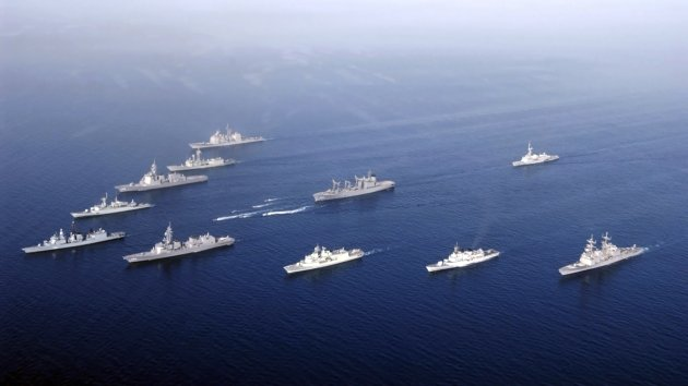 Gulf of Oman, May 6, 2004 - Ships and Rigid Hull Inflatable Boats assemble in a formation for a photo exercise.