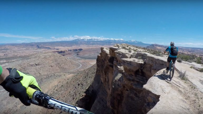 Cyclists Dice With Death on Utah Canyon Cliff Edge