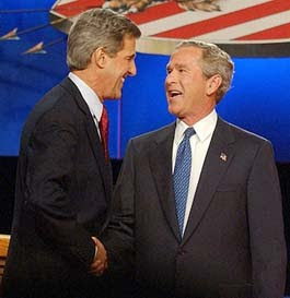 CORAL GABLES, FL - SEPTEMBER 30: President George W. Bush and Democratic rival John Kerry shake hands after their debate on the campus of the University of Miami, Septemberr 30,2004 in Coral Gables, Florida. Tonight's debate, the first of three scheduled before the November 2 election, focused on foreign policy. (Photo by Ron Sachs - Pool/Getty Images) *** Local Caption *** John Kerry