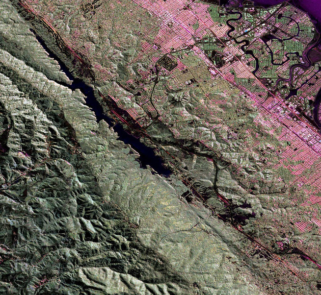 An Uninhabited Aerial Vehicle Synthetic Aperture Radar image of the San Andreas fault in the San Francisco Bay area just west of San Mateo and Foster City is shown in this image released by NASA June 17, 2009. The fault runs diagonally from upper left to lower right. The body of water along the fault line is Crystal Springs Reservoir. JPL scientists have added a new airborne radar tool to their arsenal, UAVSAR, this L-band wavelength radar flies aboard a modified NASA Gulfstream III aircraft from NASA's Dryden Flight Research Center, Edwards, Calif. The compact, reconfigurable radar, housed in a pod under the aircraft's fuselage, uses pulses of microwave energy to detect and measure very subtle deformations in Earth's surface, such as those caused by earthquakes, volcanoes, landslides and glacier movements. REUTERS/NASA/JPL/Handout (UNITED STATES SCI TECH) FOR EDITORIAL USE ONLY. NOT FOR SALE FOR MARKETING OR ADVERTISING CAMPAIGNS