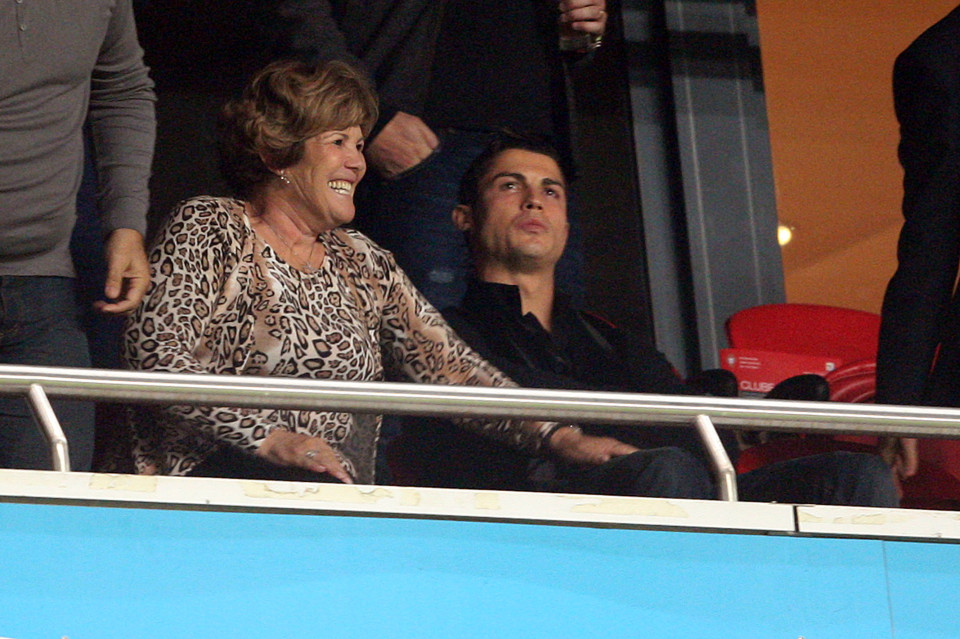 Portugal's Cristiano Ronaldo sits in the stand with his mother