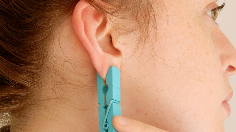 She Puts a Clothespin On Her Ear For One Brilliant Reason