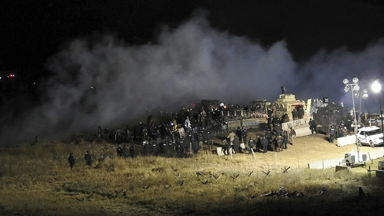 400 DAPL Protesters 'Trapped on Bridge' As Police Fire Tear Gas, Water Cannon
