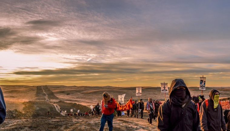 """STANDING ROCK CAMP BEING SPRAYED WITH """"CHEMICAL AGENTS"""" BY LOW FLYING AIRCRAFTS AT NIGHT"""