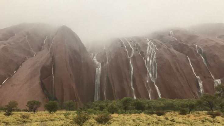 Twice-A-Century Freak Weather Event…..Ayers Rock Turned Into Massive Waterfall After Heavy Rain Falls On Iconic Landmark