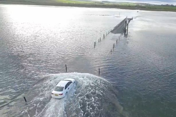 Drone Captures Uber Driver Racing Rising Sea Tide At Holy Island With Stranded Buddhist Monk In The Back