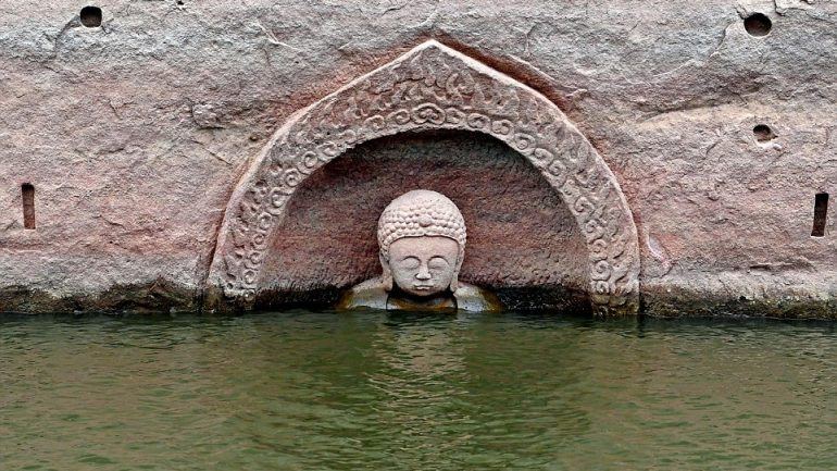 Found: A 400-Year-Old Buddha Statue, Hidden Under a Manmade Lake