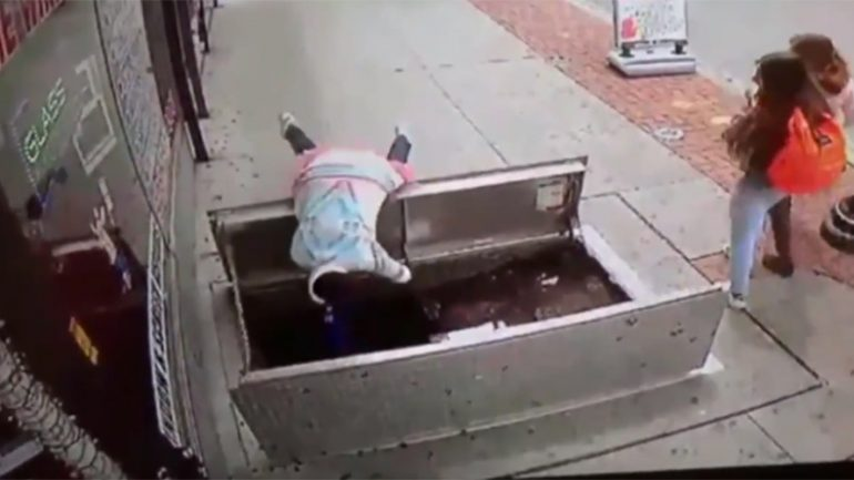 Woman Distracted By Phone Tumbles Through Sidewalk Trapdoor
