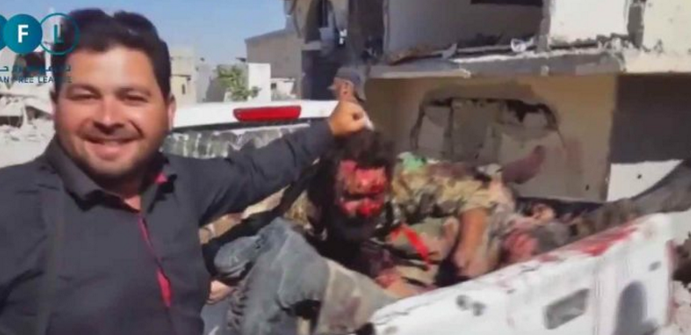 Gruesome Video Shows Oscar Winning White Helmets Beheading, Dumping Syrian Army Bodies