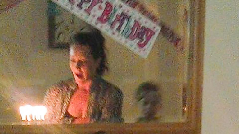 Ghost Photobombs Birthday Party – Family Snap Eerie Pic Of A Ghost Boy Peering Into A Mirror During Her Daughter's Birthday