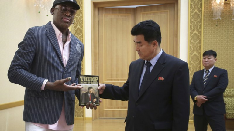 """Dennis Rodman Is Insane…….Gives North Korea Trump Themed Gift….. Copy of """"Art of the Deal"""""""