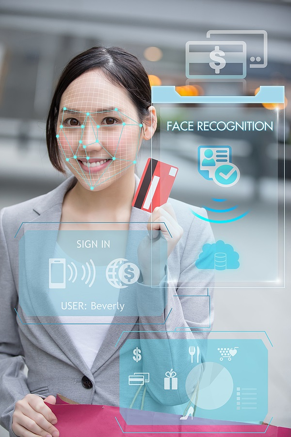Asian Businesswoman Using Credit Card To Payment With Facial Rec